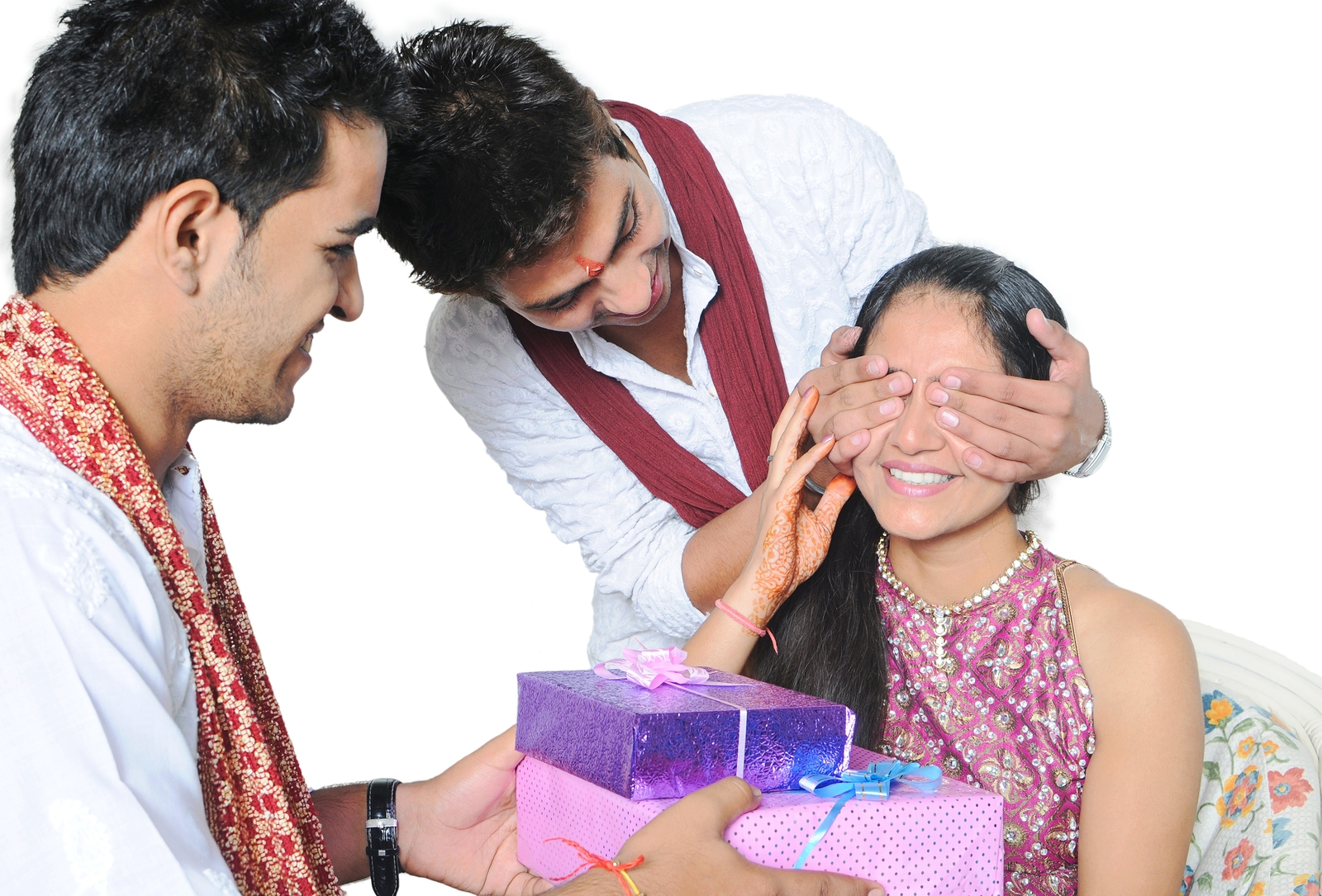 Two brothers giving surprise gift to their sister on festival.