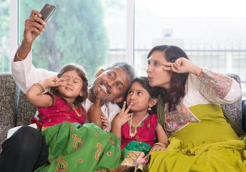 asian family taking a selfie