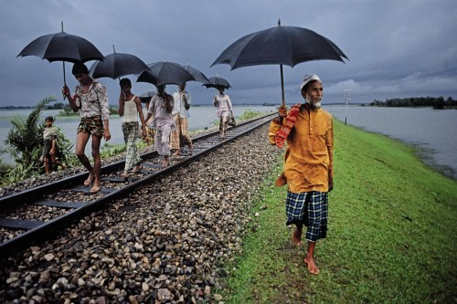 Built to remain above the annual inundation. The tracks are often occupied by entire villages, camping till the floods subside, Bangladesh, 1983National Geographic, June 1984, By Rail Across the Indian Subcontinent, Phaidon, The Unguarded Moment, Iconic Images, final book_iconic, final print_milan
