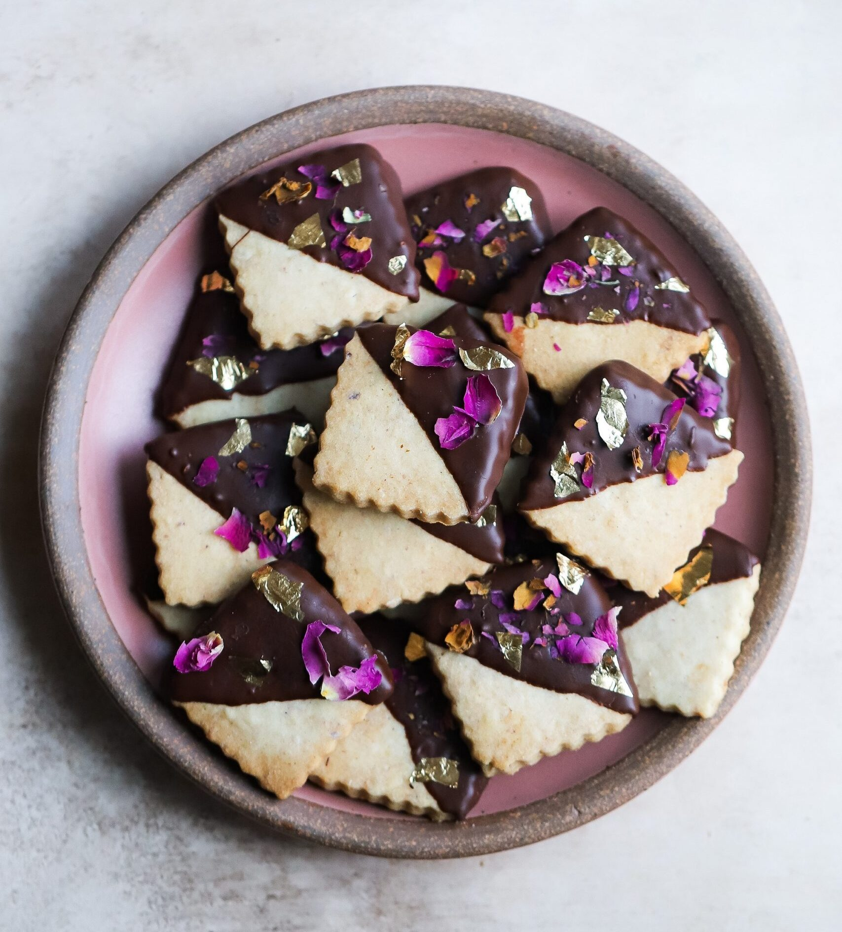 LNUT AND CARDAMOM SHORTBREAD dipped in ROSE INFUSED CHOCOLATE:
